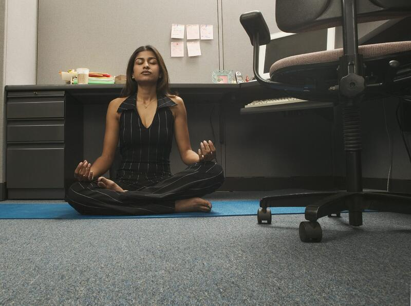 woman doing yoga in office